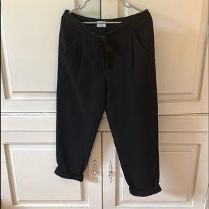 Aritzia Black crepe cropped cuffed dress pants